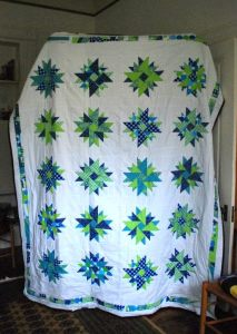 Double Aster Quilt by Pieced Together Quilts
