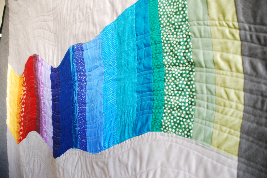 Rainbow Quilt by Pieced Together Quilts